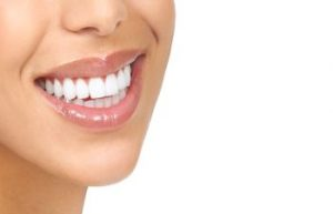 Patient Smiling After Porcelain Veneers from Kennesaw Mountain Dental Associates