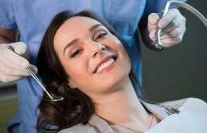 Woman Smiling in Dentist Chair Kennesaw GA